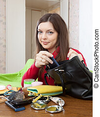 Girl can not finding anything in her purse at table