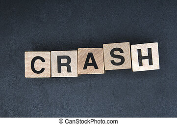 Crash - Wooden cubes spelling crash