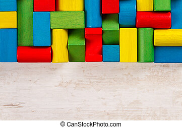 Toys blocks, multicolor wooden bricks, copy space with group of colorful building game pieces