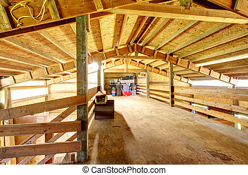 Large farm horse stable barn. - Wooden interior of horse...