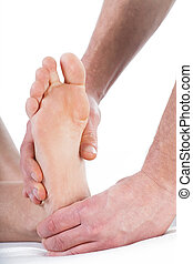 Professional foot massage at physiotherapy center