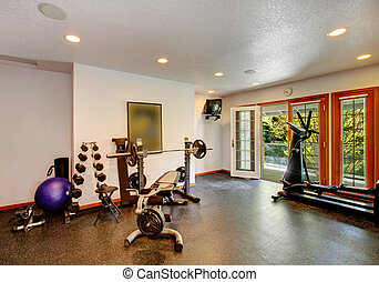 Home gym interior - White and black home gym with different...
