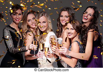 Best friends having a new year party - Girls with a glass of...