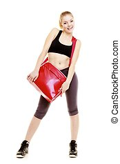 Happy sporty girl holds red gym bag ready for fitness exercise