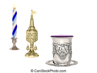 Havdalah set, selective focus on silver wine cup, isolated...