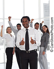 Business Team Celebrating success with leader in foreground