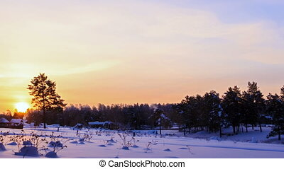 Sun rises over the winter landscape. Time Lapse