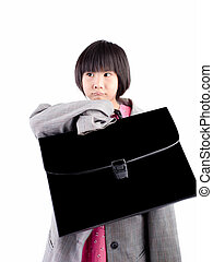 Portrait of a girl wearing oversized suit and holding briefcase