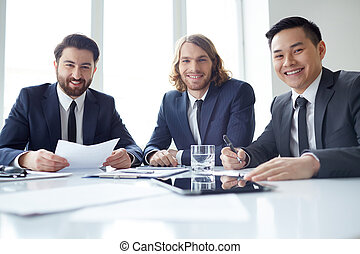 Male chiefs - Portrait of three partners at meeting table