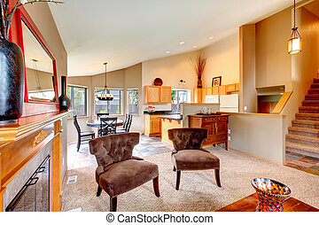 Open plan design for kitchen with dining area and living...