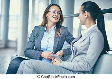 Business ladies talking - Image of two confident...