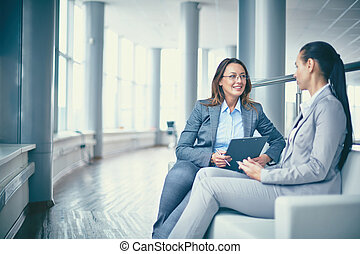 Discussing strategy - Image of two friendly businesswomen...