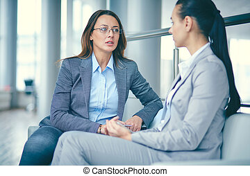 Business talk - Image of two businesswomen sitting and...