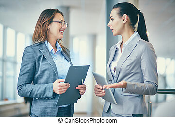 Business conversation - Image of two confident businesswomen...