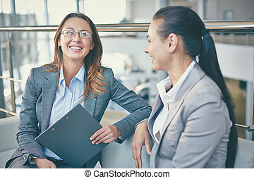 Happy talk - Image of smiling businesswoman with clipboard...