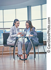 Business discussion - Image of two friendly businesswomen...