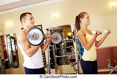 Strong young people - Couple exercising with weights
