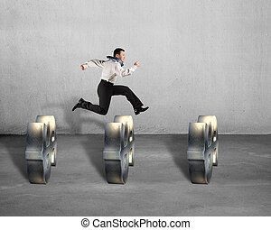 Businessman jumping over USD symbols concrete background