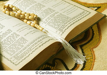 tasbih - moslem prayer beads at prayer mat