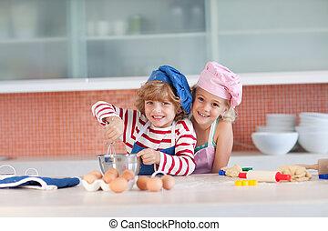 Children having fun in the Kitchen - Young Children having...