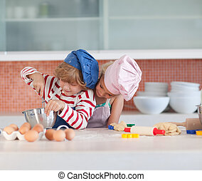 Children having fun in the Kitchen - Young Children having...