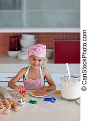 Beautiful young Girl Working in the Kitchen baking