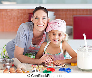 Mother and childing in Kitchen Smiling at Camera - Young...