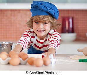 Young boy baking in the kitchen