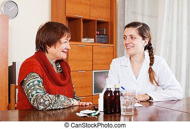 happy  doctor prescribing medication to senior woman