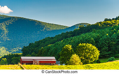 Red barn and view of the Blue Ridge Mountains, in the...