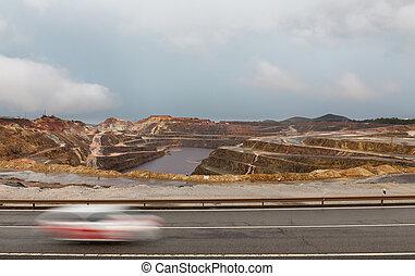 Rio Tinto mine and car trail - Copper mine open pit in Rio...