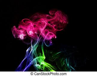 Abstract color smoke on black.