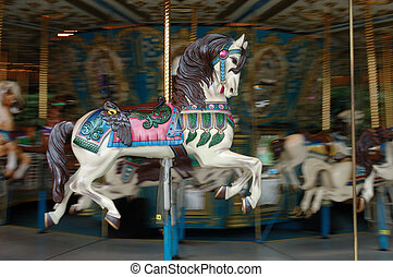 Carousel horse on a moving merry go round