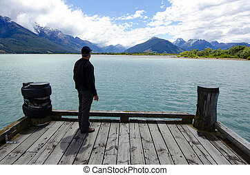 Glenorchy New Zealand NZ NZL - Man looks at dramatic...