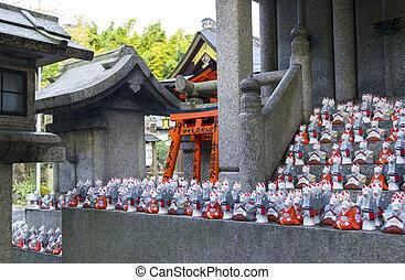 Fox statues at shrine - Little fox statues at Fushimi Inari...