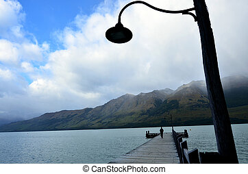 Glenorchy New Zealand NZ NZL - Man walks on Glenorchy wharf,...