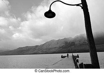Glenorchy New Zealand NZ NZL - Man walks on Glenorchy wharf,...