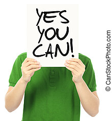 Yes You Can  - A young man holding a motivational poster
