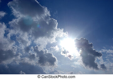 Sun shinning through the clouds in blue sky