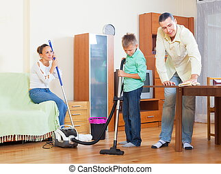 Ordinary family cleaning together - Ordinary family of three...