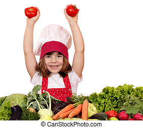 happy little girl cook with tomatoes and vegetables