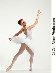 Young ballerina dancer in tutu showing her techniques