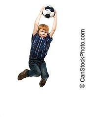 Little boy with soccer ball jumping