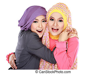 Two beautiful moslem woman having fun together - Portrait of...