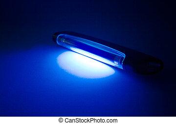UV lamp - uv lamp on table. blue