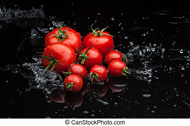 tomatoes in water - small group of fresh tomatoes lying over...