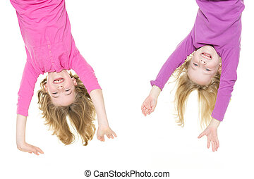 Hanging little girls - Smiling young girls hanging in front...