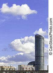 High-rise building at noon - High-rise building in...