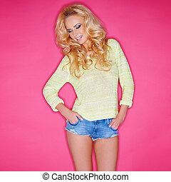 Glamorous blond in trendy skimpy denim shorts - Glamorous...