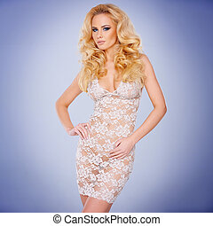 Glamorous young blond in a see-through dress - Glamorous...